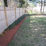 Bed edged straight and mulched with Hemlock